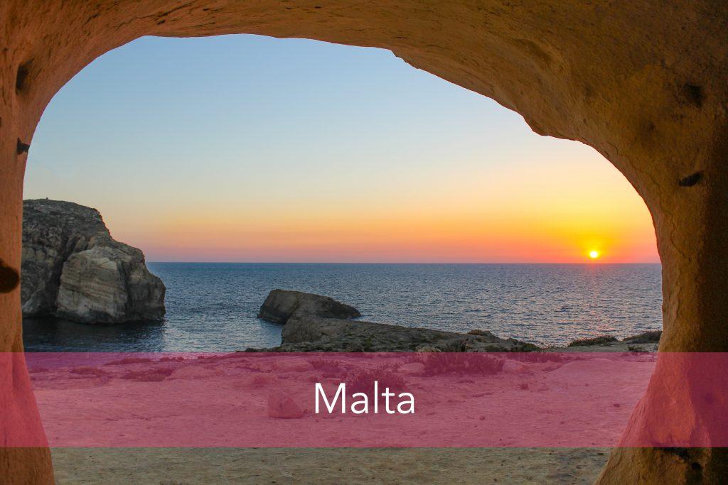Beach cave in Malta with sunrise